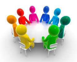 Personer vid ett runt bord